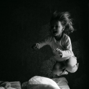 A child jumping into bed